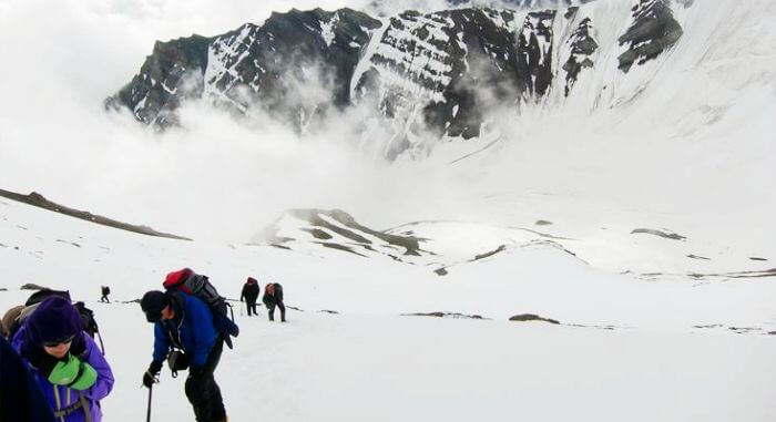 Trekkers climb the Stok summit as a part of lamayuru-stok trek