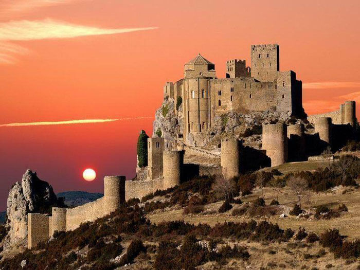 Sun sets down at a castle in Huesca