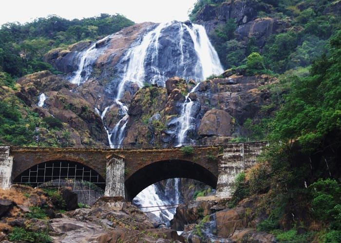 The railway bridge in front of the majestic Dudhsagar falls in Goa