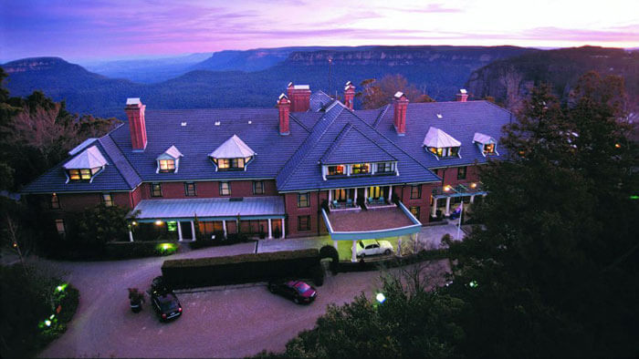The Lilianfels Blue Mountains Resort and Spa against a background of the blue hills