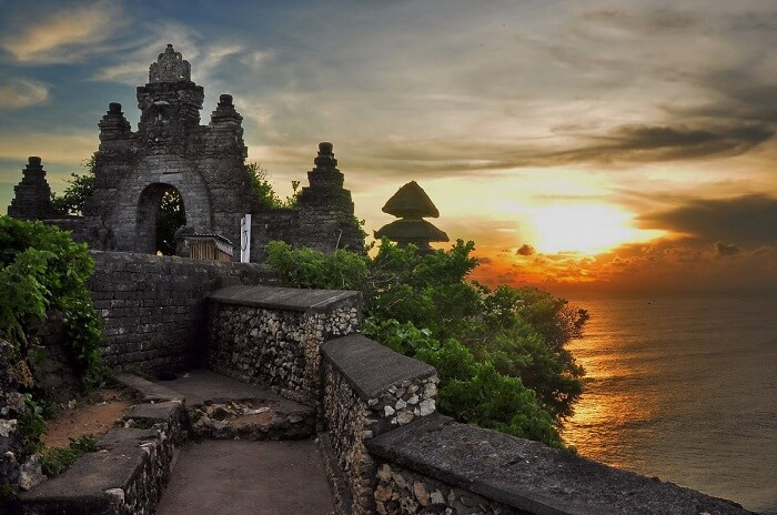 Sunset view at the hill top Puru Luhur Uluwatu temple in Bali