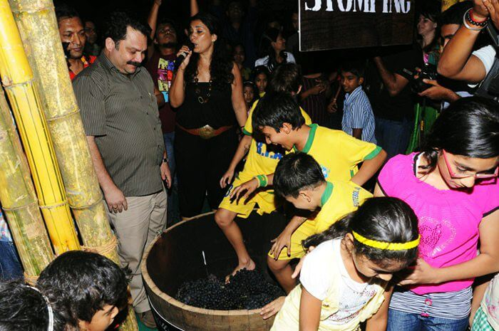 Kids enjoying wine stomping at the most unique festival in Goa & in India - The Grape Escapade