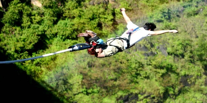 A man tries bungee jumping at a location in India