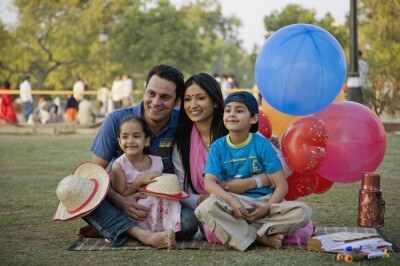 A family enjoys a holiday at a picnic spot near Kolkata
