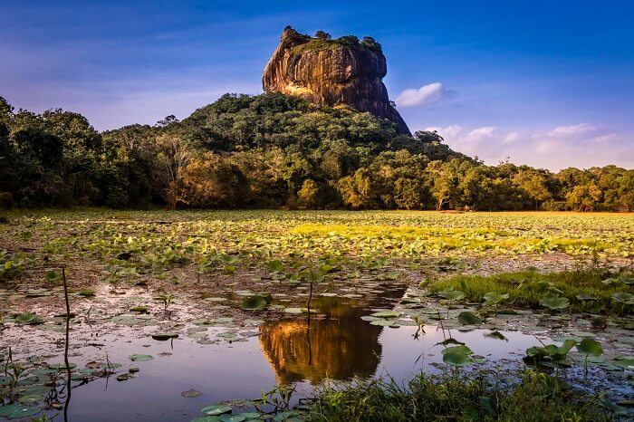 The reflection and the fortress of Sigiriya Rock in Sri Lanka