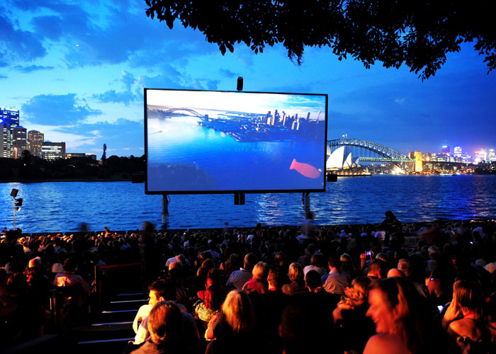 At St George Oper Air Cinema you can watch the screen rise, breaking the water surface, with the Opera House the Harbor Bridge, and the setting sun in the backdrop