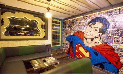 The Superman photo wall inside the Superhero Café