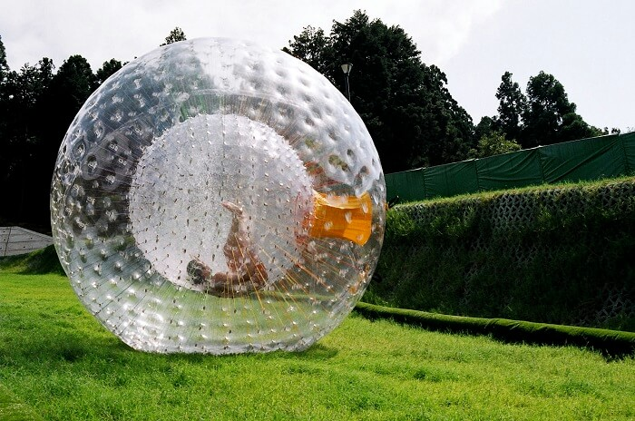 A person indulging in Zorbing in Manali