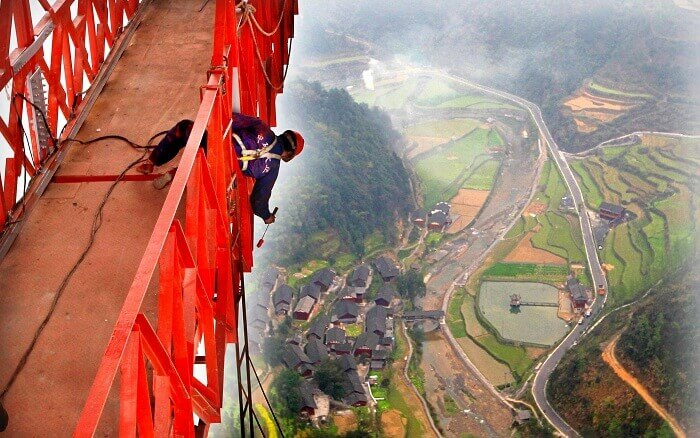 The view of the city below from the Aizhai suspension bridge in China