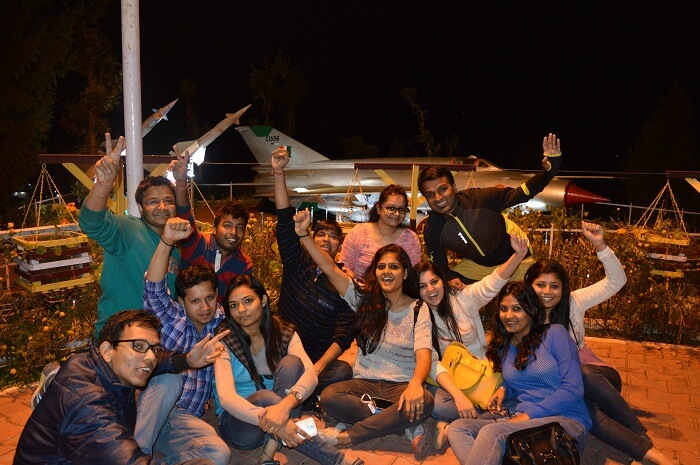 Shivani and friends posing in front of an airplane model in Dalhousie hills