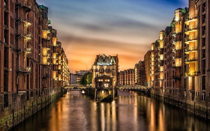 The illuminated canal city of Hamburg in Germany at night