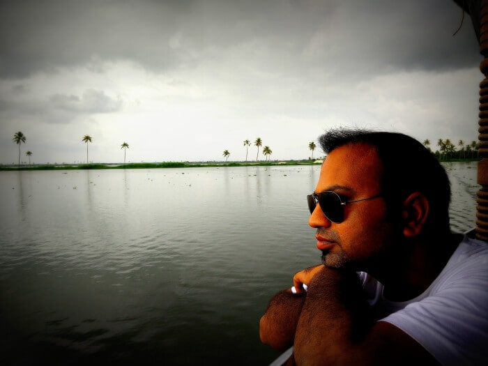 Rahul enjoying the view of backwaters from his Alleppey Boathouse