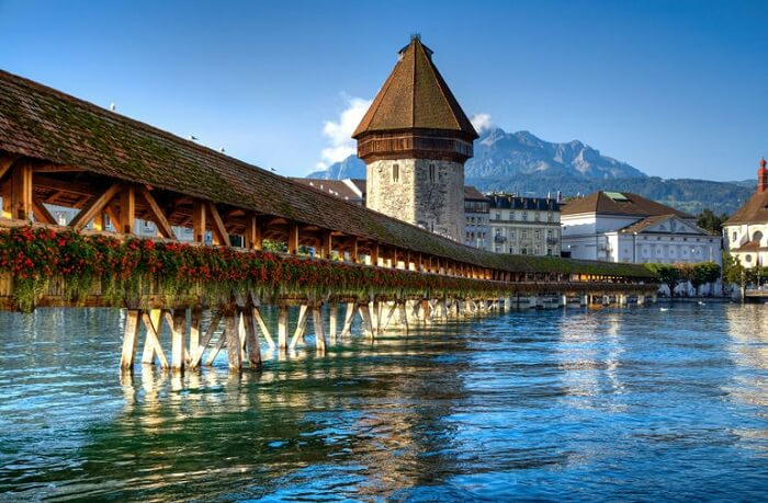 The Chapel Bridge made of wood in Lucerne is one of the major Switzerland tourist attractions
