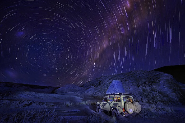 Camping on a jeep top under the gorgeous night sky and stars