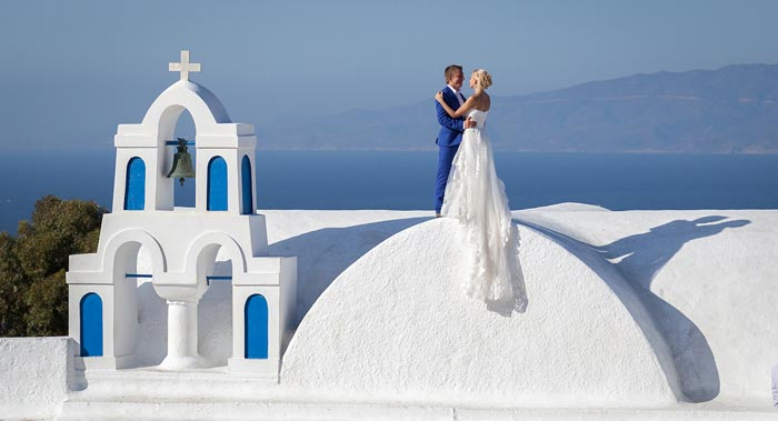 A couple in the city of Santorini, Greece