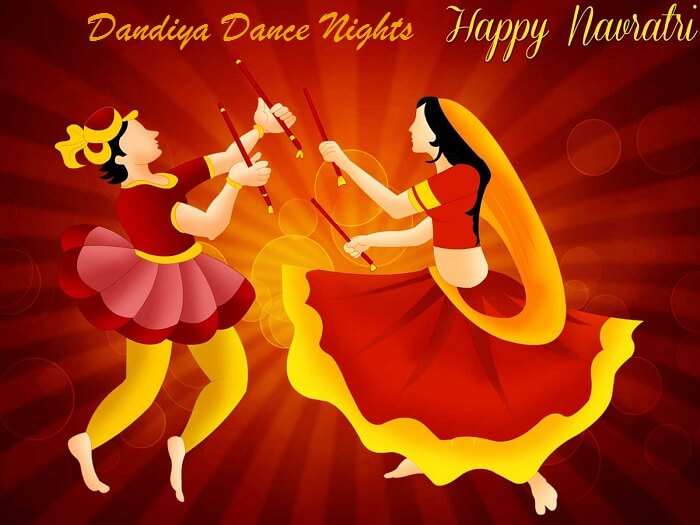 Couple celebrating navaratri and doing dandiya