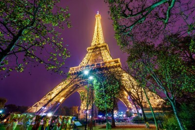 A scenic view of the Eiffel tower at night