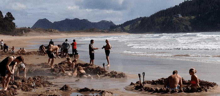 Honeymoon places in New Zealand include Hot Water Beach where you can dig your own pool