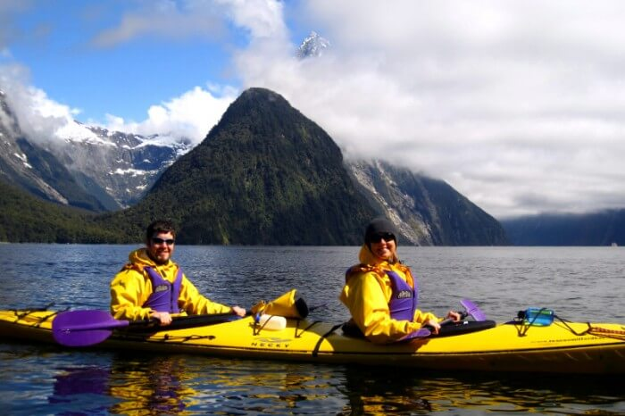 Honeymooners enjoy Kayaking in the beautiful backgrounds of Milford Sound