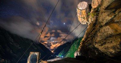 A night shot of skylodging in Peru