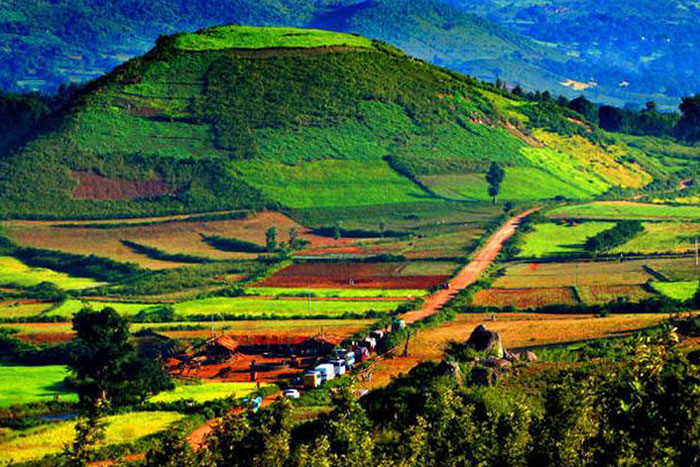 A breathtaking view of the Araku Valley landscape with multicolored pastures