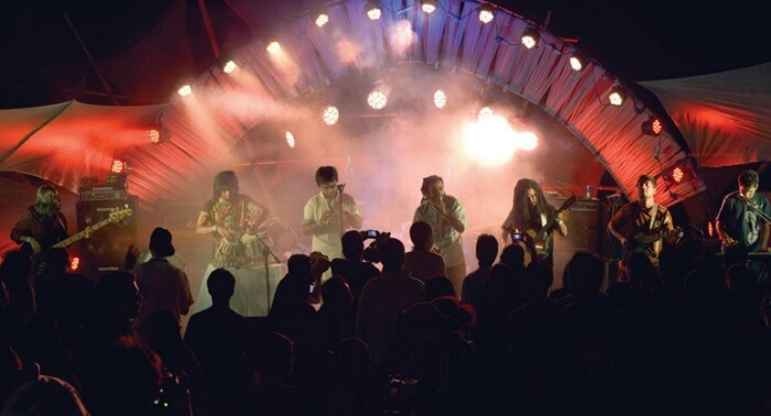 A band of seven performing at the Escape Festival