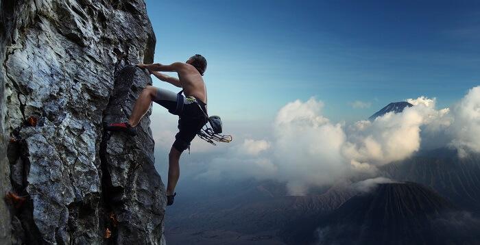 A man climbing a rocky mountain