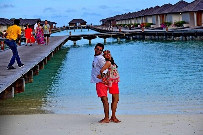 Yatin and his wife posing at the dock in Paradise Island Beach Resort