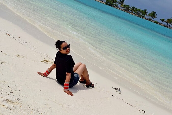 Yatins wife on the beach in Paradise Resort Maldives