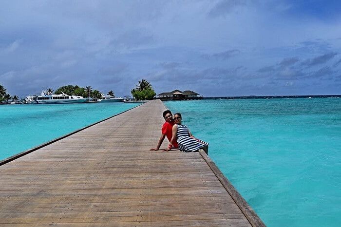 Yatin and wife in the background of the sea in Maldives