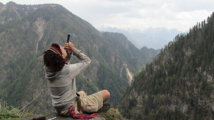A young tourist smoking hash in Kasol