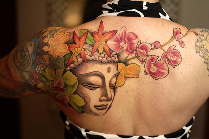 A woman bearing a tattoo at a tattoo parlour in Darjeeling