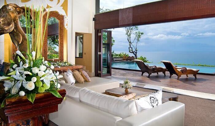 The view of the living room overlooking the blue waters of Indian Ocean at Ayana Resort villas