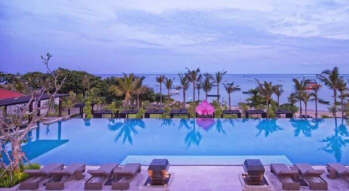 The 50 m long infinity pool adds at the Fairmont beach resort in Bali