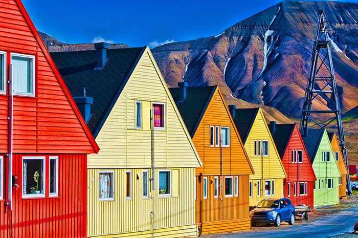 The coloured houses sparkle by the midnight sun in Longyearbyen