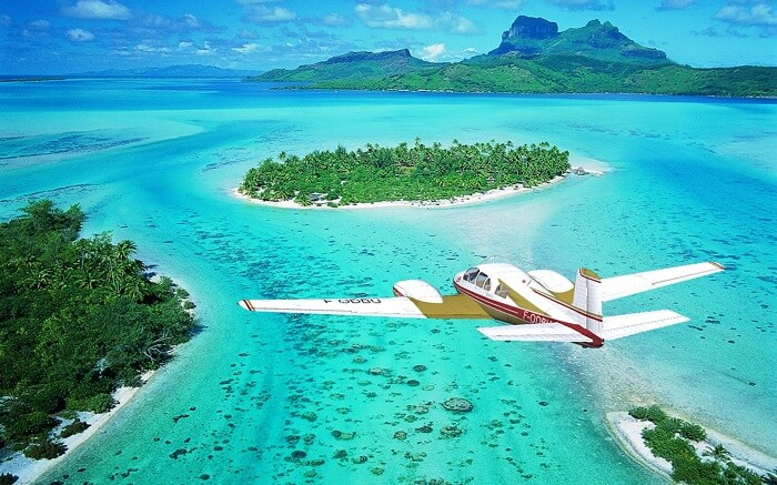 The Air Tahiti flight over the blue waters of Polynesia