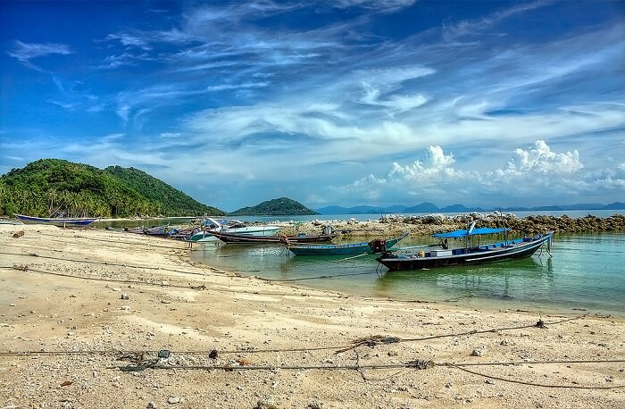 Fishing boats at the seashore of Taling Ngam Beach