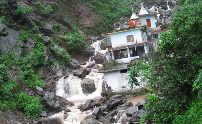 Badolia Baba Temple with a beautiful waterfall backdrop
