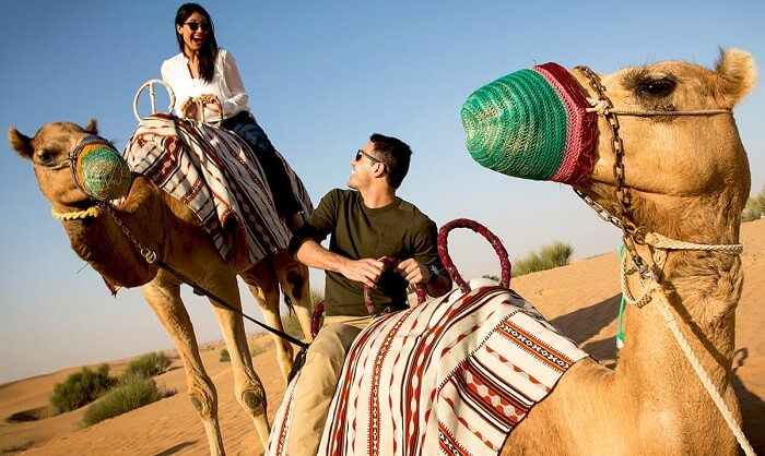 A couple indulging in camel safari during Dubai Shopping Festival 2016