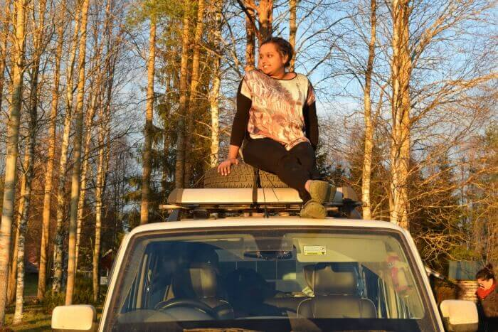 Nidhi relaxing on top of the car like a boss