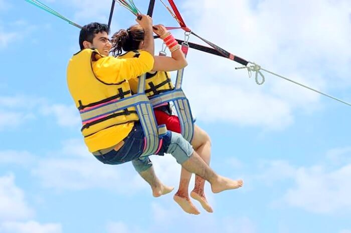 Tarun and his wife parasailing in Ile Aux Cerfs