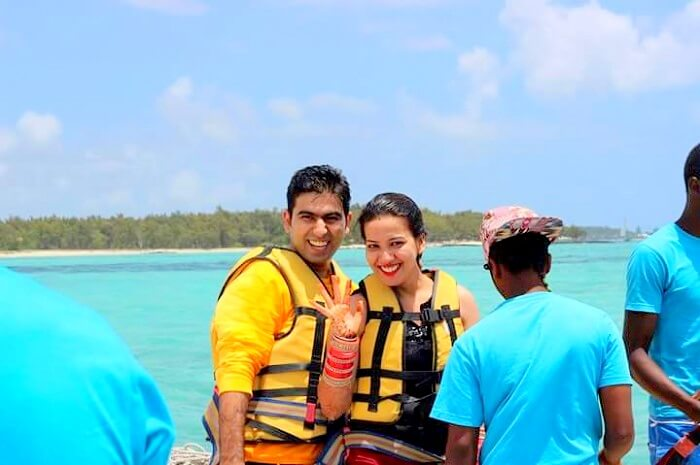 Tarun and his wife on a speedboat in Ile Aux Cerfs