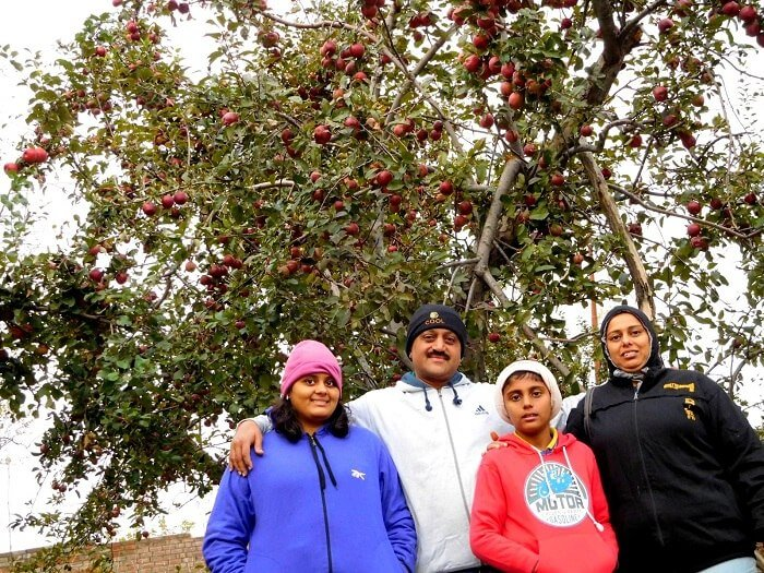 Sharad and his family in the apple meadows of Kashmir