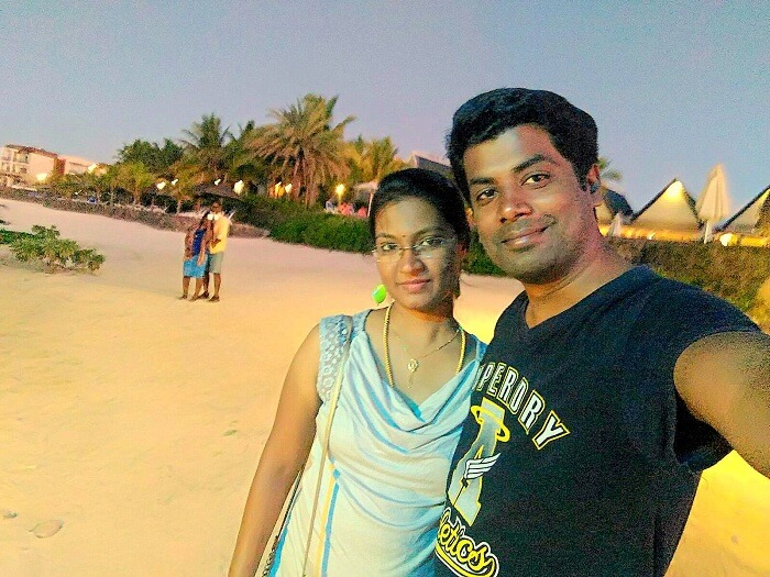 Karthik and his wife on the beach in Mauritius