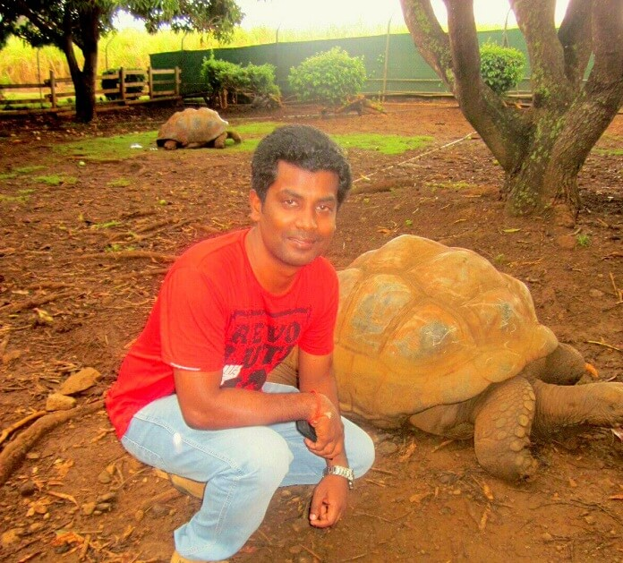 Karthik with a tortoise in Casela Nature Park Mauritius