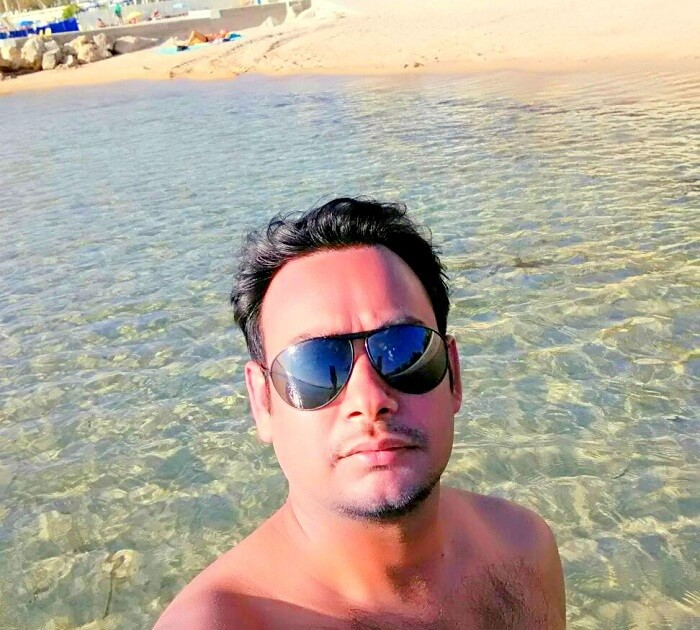 Niket clicks a selfie on the beach in Nice