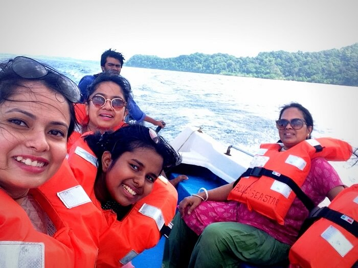 with 5 members on the speed boat to Red Skin Island