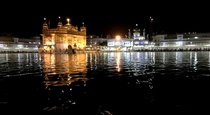 Golden Temple lit with lights at night