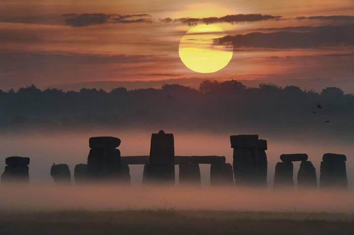 The amazing view of the Stonehenge and the midnight sun over Salisbury