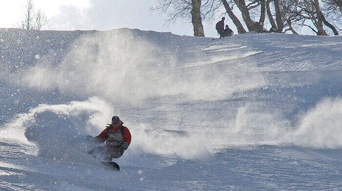Ski-Resort-A person tries snowboarding at Auli Ski Resort